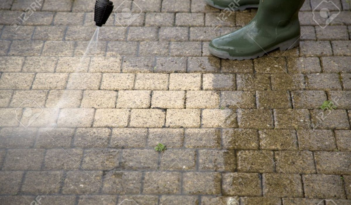 20831082-Outdoor-floor-cleaning-with-high-pressure-water-jet-Stock-Photo